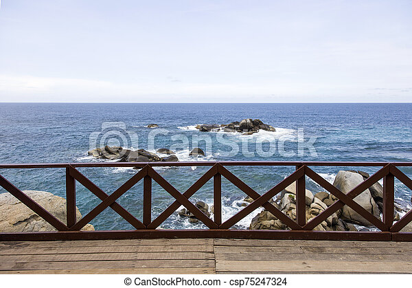 Wooden fence on the pier at Caribbean sea - csp75247324