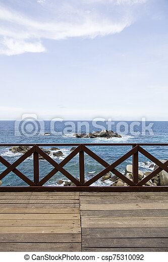 Wooden fence on the pier at Caribbean sea - csp75310092
