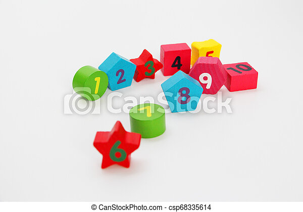 Wooden figures with numbers 1, 2, 3, 4, 5, 6, 7, 8, 9 and 10. Wooden cubes with numbers for children. - csp68335614