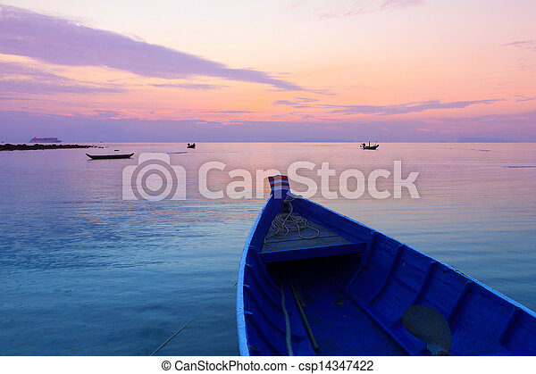 Wooden fisherman boat at sunset, Thailand - csp14347422
