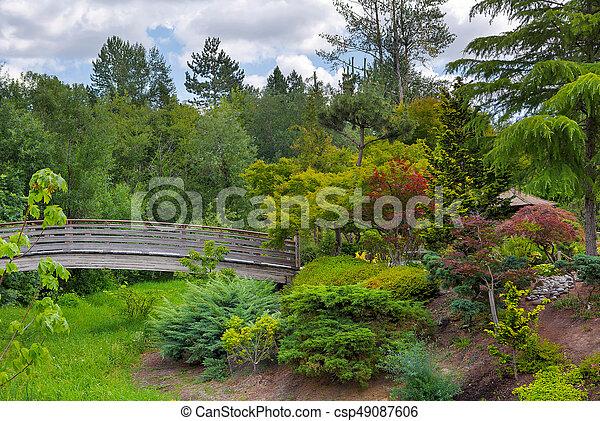Wooden Foot Bridge at Tsuru Island Japanese Garden - csp49087606