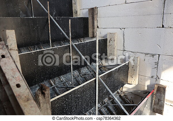 wooden formwork and steel bar ready for concrete stairs construction - csp78364362