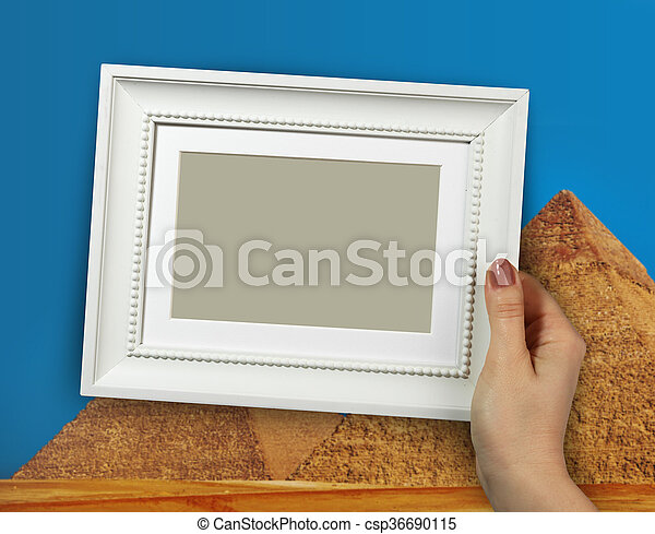 Wooden frame in woman hands on the camel with pyramids background - csp36690115