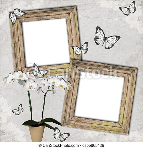 Wooden frames with butterfly and orchids on grange background .