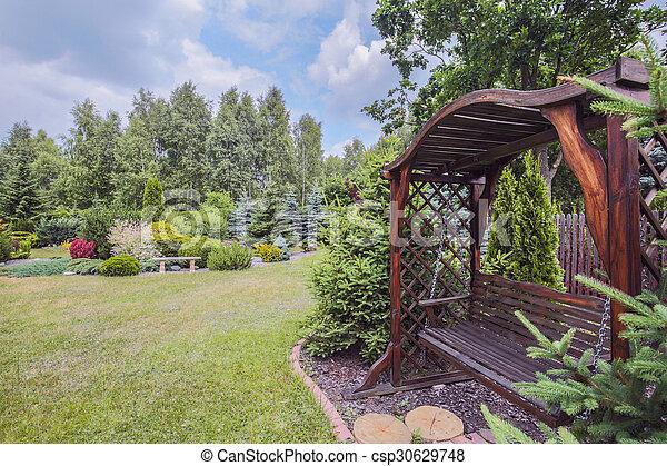 Wooden garden bench - csp30629748
