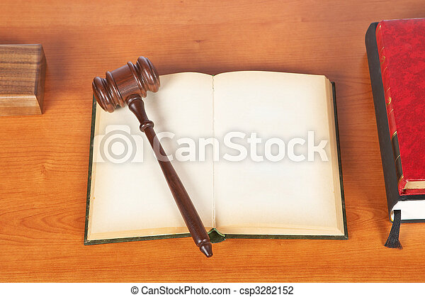 Wooden gavel and law book - csp3282152