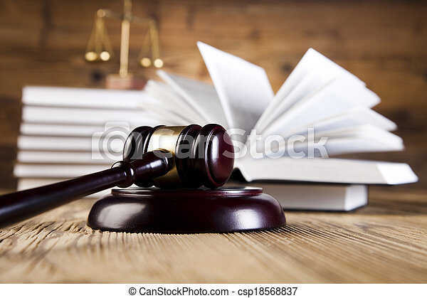 Wooden gavel and law books - csp18568837