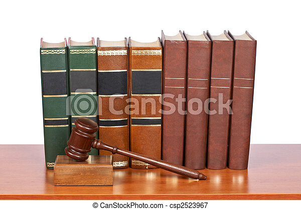 Wooden gavel and old law books - csp2523967