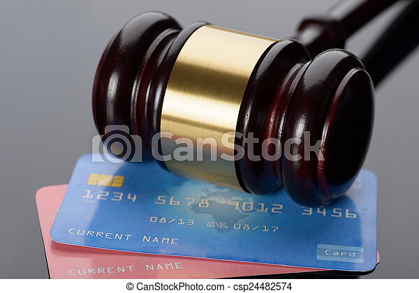 Wooden Gavel With Credit Card - csp24482574