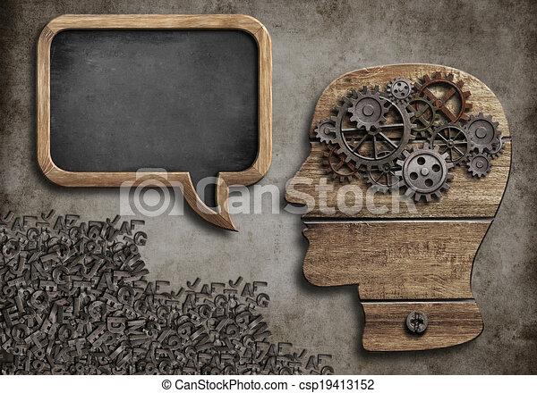 wooden head with speech bubble blackboard - csp19413152