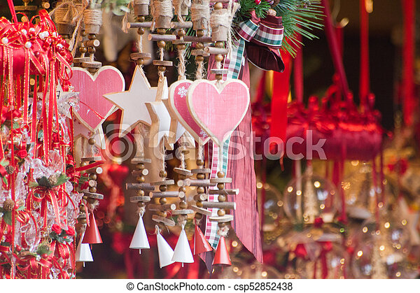 Wooden hearts and stars ornaments with small red and white bells - csp52852438