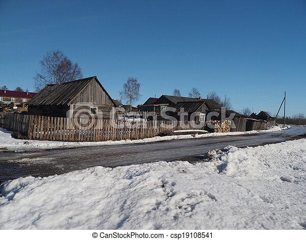 Wooden house in winter village - csp19108541