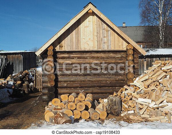 Wooden house in winter village - csp19108433