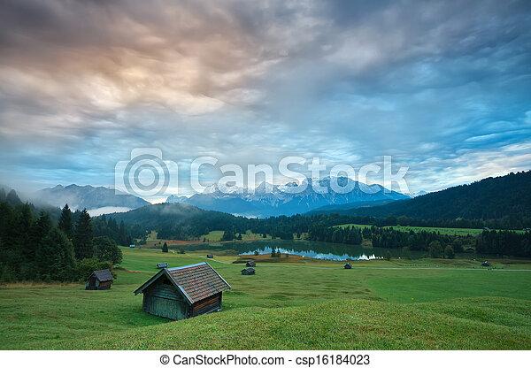 wooden hut o meadow by Geroldsee lake at sunrise - csp16184023