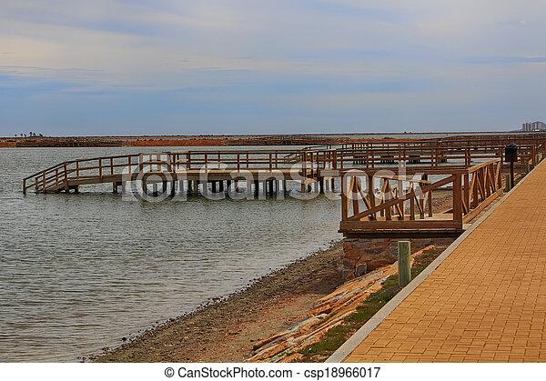 wooden jetty over a calm sea - csp18966017