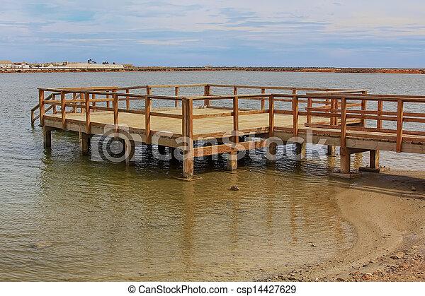 wooden jetty over a calm sea - csp14427629