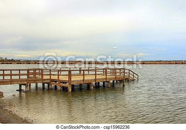wooden jetty over a calm sea - csp15962236