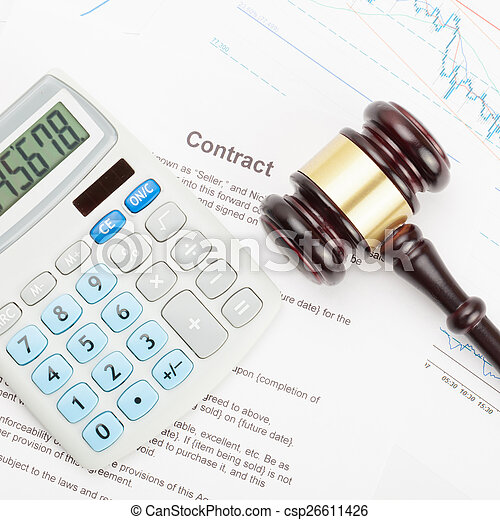 Wooden judge's gavel and calculator over contract - close up shot