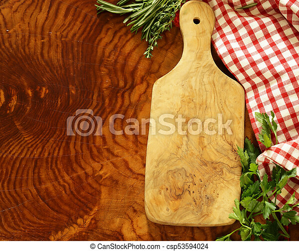wooden kitchen table background with napkin - csp53594024
