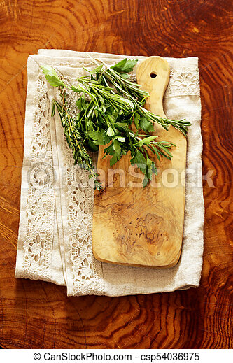 wooden kitchen table with napkin for background - csp54036975