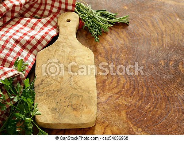 wooden kitchen table with napkin for background - csp54036968