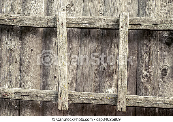 wooden ladder on the wall - csp34025909