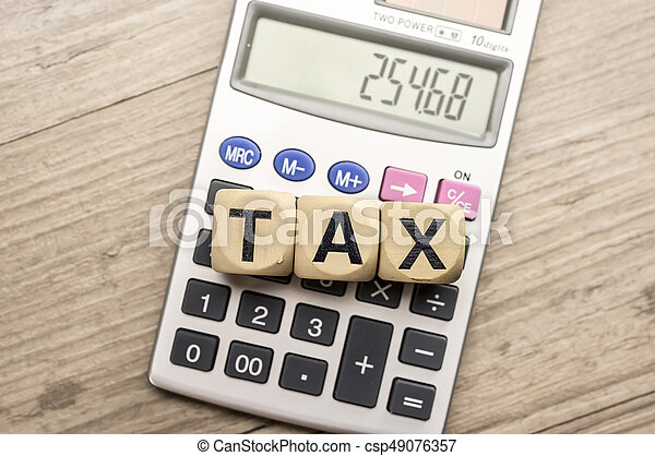 Wooden letter block assemble the word tax and calculator - csp49076357