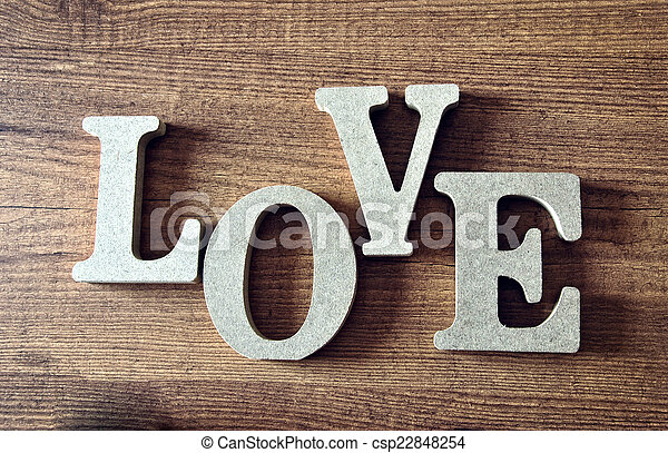 wooden letters with word love - csp22848254