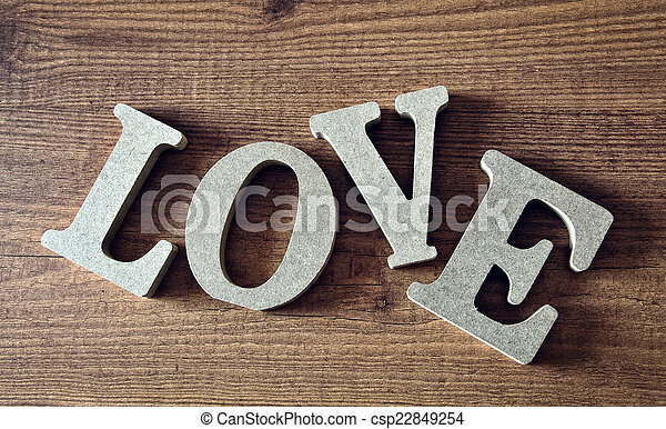 wooden letters with word love - csp22849254