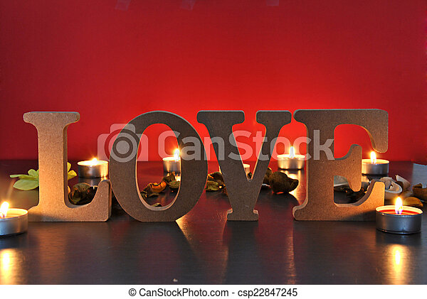 wooden letters with word love - csp22847245