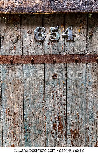 Wooden old prison door closeup - csp44079212 & Wooden old prison door closeup. jail door with number 654.