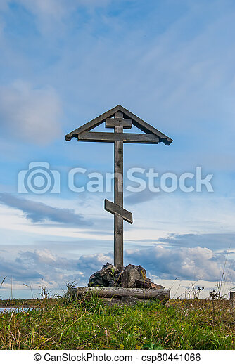 Wooden orthodox cross against a bright sky - csp80441066