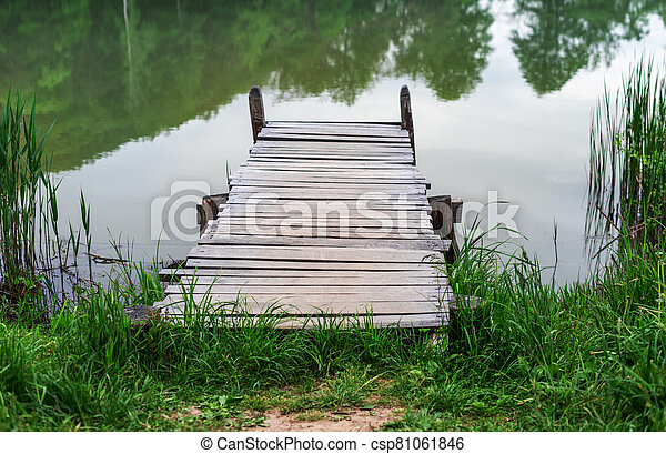 Wooden pier on the lake. - csp81061846
