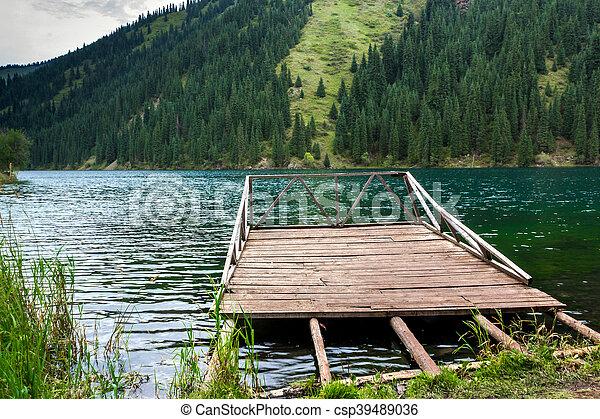 Wooden pier on the mountain lake - csp39489036