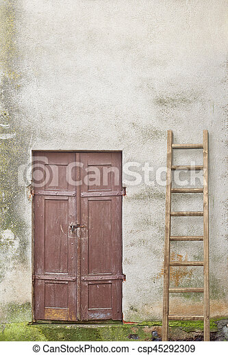 wooden plank door and ladder - csp45292309