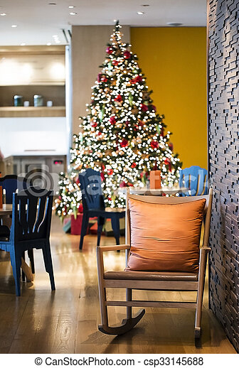 Fabulous Wooden Rocking Chair With Orange Scatter Cushion In Living Room Decorate With Blurry Chirstmas Tree Machost Co Dining Chair Design Ideas Machostcouk