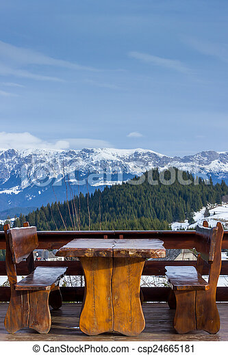 Wooden rustic furniture over mountain landscape - csp24665181