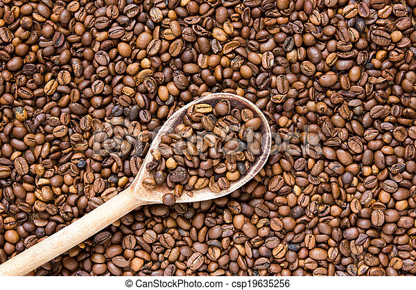Wooden scoop with coffee beans - csp19635256