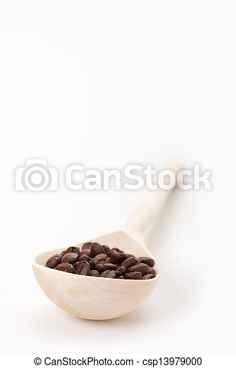 wooden spoon with coffee beans, isolated - csp13979000