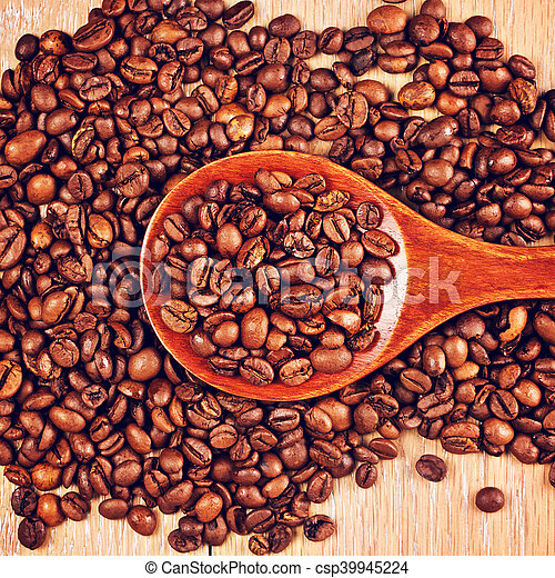 Wooden Spoon With Coffee Beans - csp39945224