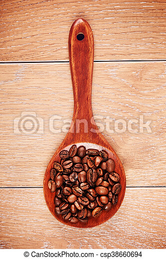 Wooden Spoon With Coffee Beans - csp38660694