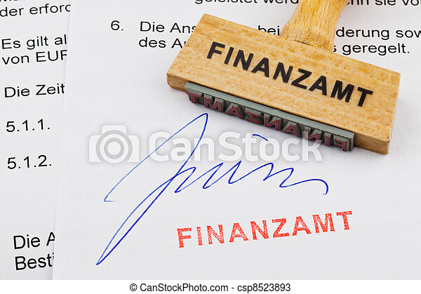 wooden stamp on the document: tax office - csp8523893