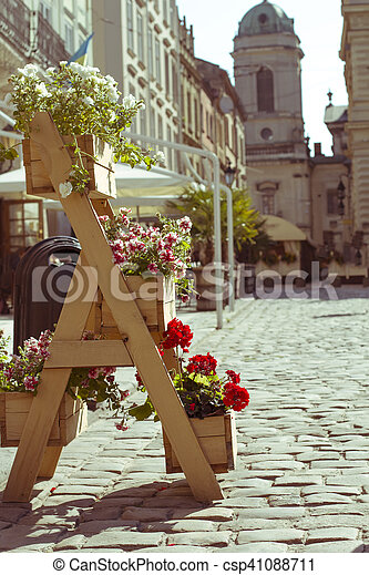 wooden stand for flowers in the city - csp41088711