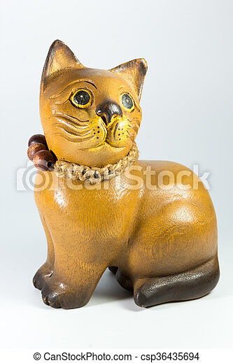 wooden statuette of a cat on white background - csp36435694