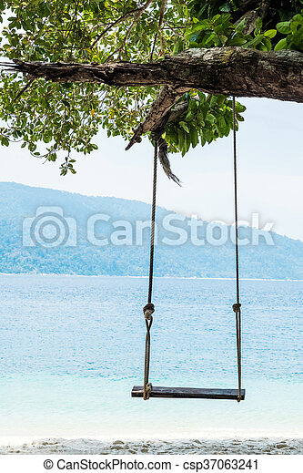 Wooden swing on the beach - csp37063241