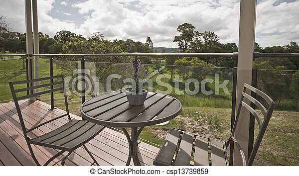 Wooden table and chairs on a deck - csp13739859