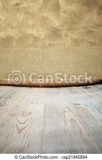 Wooden table with background - csp21945894