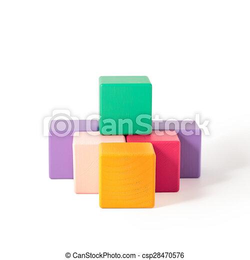Wooden toy blocks on white background - csp28470576