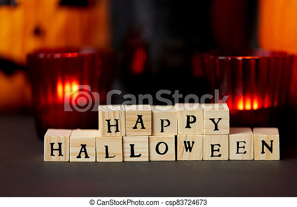 wooden toy blocks with happy halloween letters - csp83724673