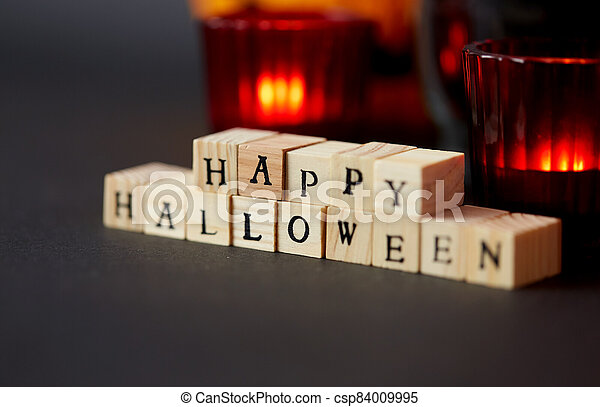 wooden toy blocks with happy halloween letters - csp84009995